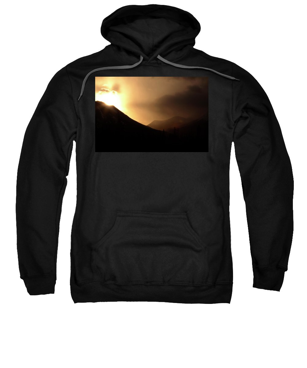 Sun Sweatshirt featuring the digital art Sun Behind Clouds In Rocky Mountains Of Alberta Canada by Mark Duffy