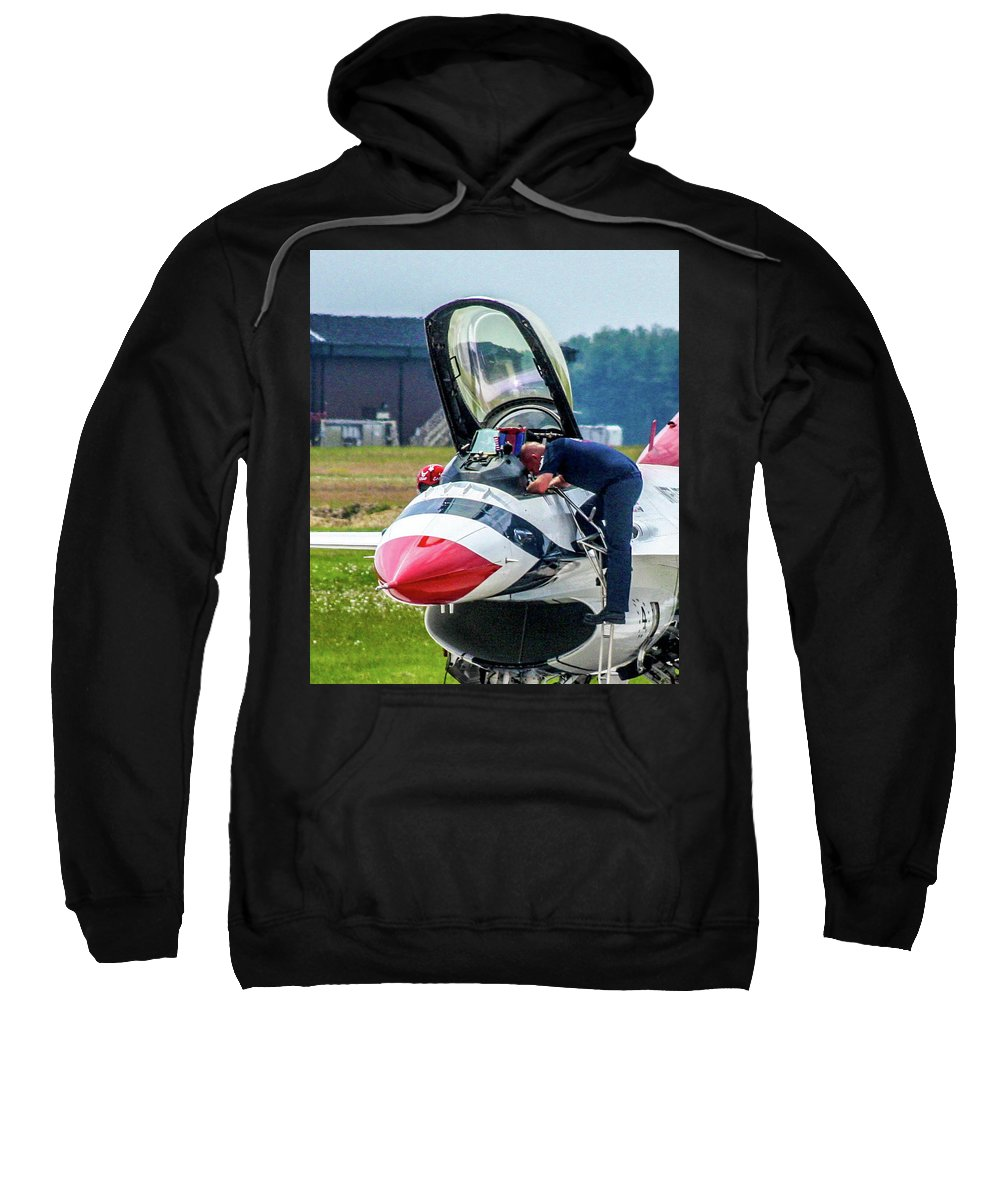 This Is A Photo Of One Of The Ground Crew To The United States Air Force Thunderbird Performance Team At Mcguire Air Force Base Sweatshirt featuring the photograph The United States Thunderbirds by William Rogers