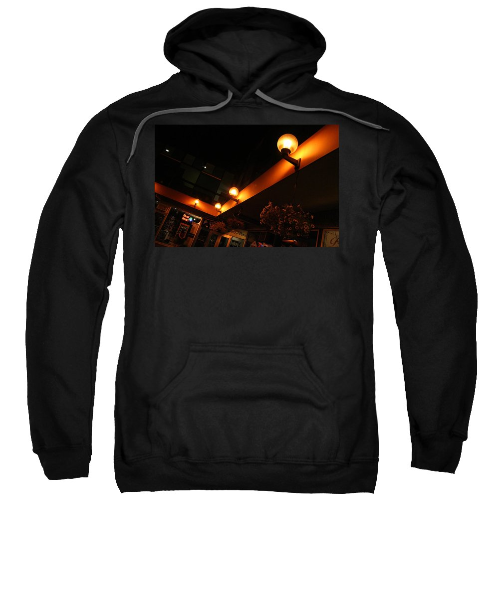 Storefront Sweatshirt featuring the photograph Under The Lights Of Old Colorado City by Ric Bascobert