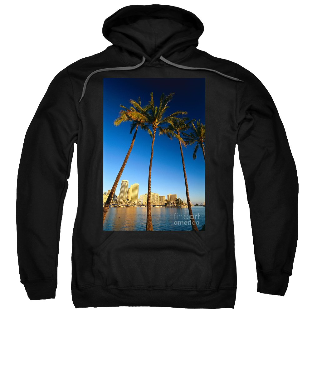 Across Sweatshirt featuring the photograph Waikiki Skyline by Carl Shaneff - Printscapes