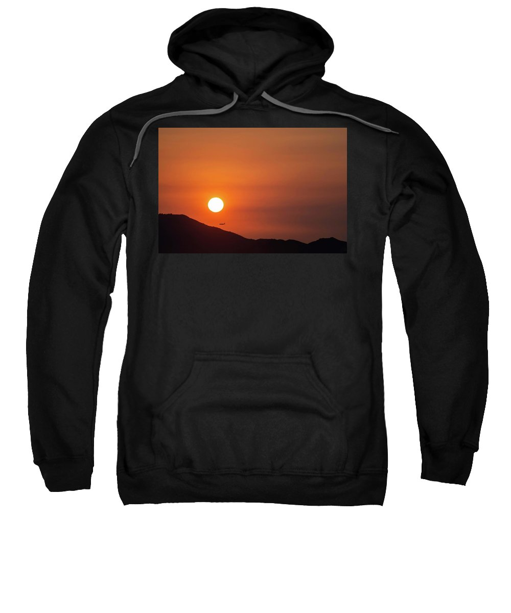 Sunset Sweatshirt featuring the photograph Red sunset and plane in flight by Hannes Roeckel