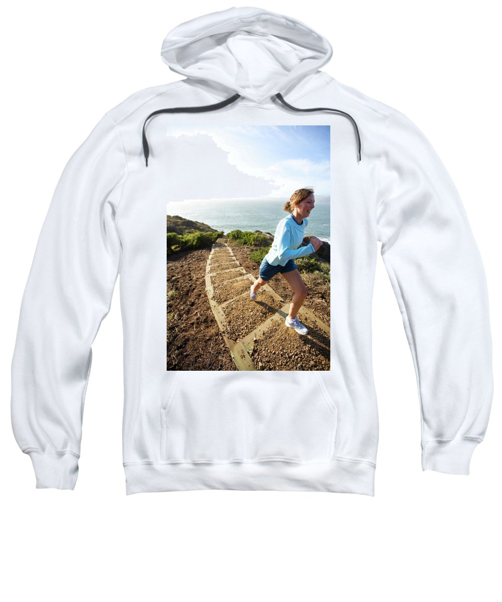 California Sweatshirt featuring the photograph A Woman Running Stairs Near The Ocean by Corey Rich