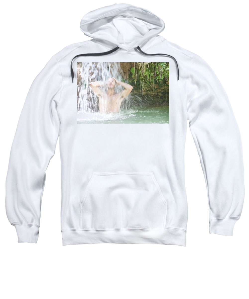 Agua Azul Cascades Sweatshirt featuring the photograph A Young Man Stands Under The Cascades by Jose Azel