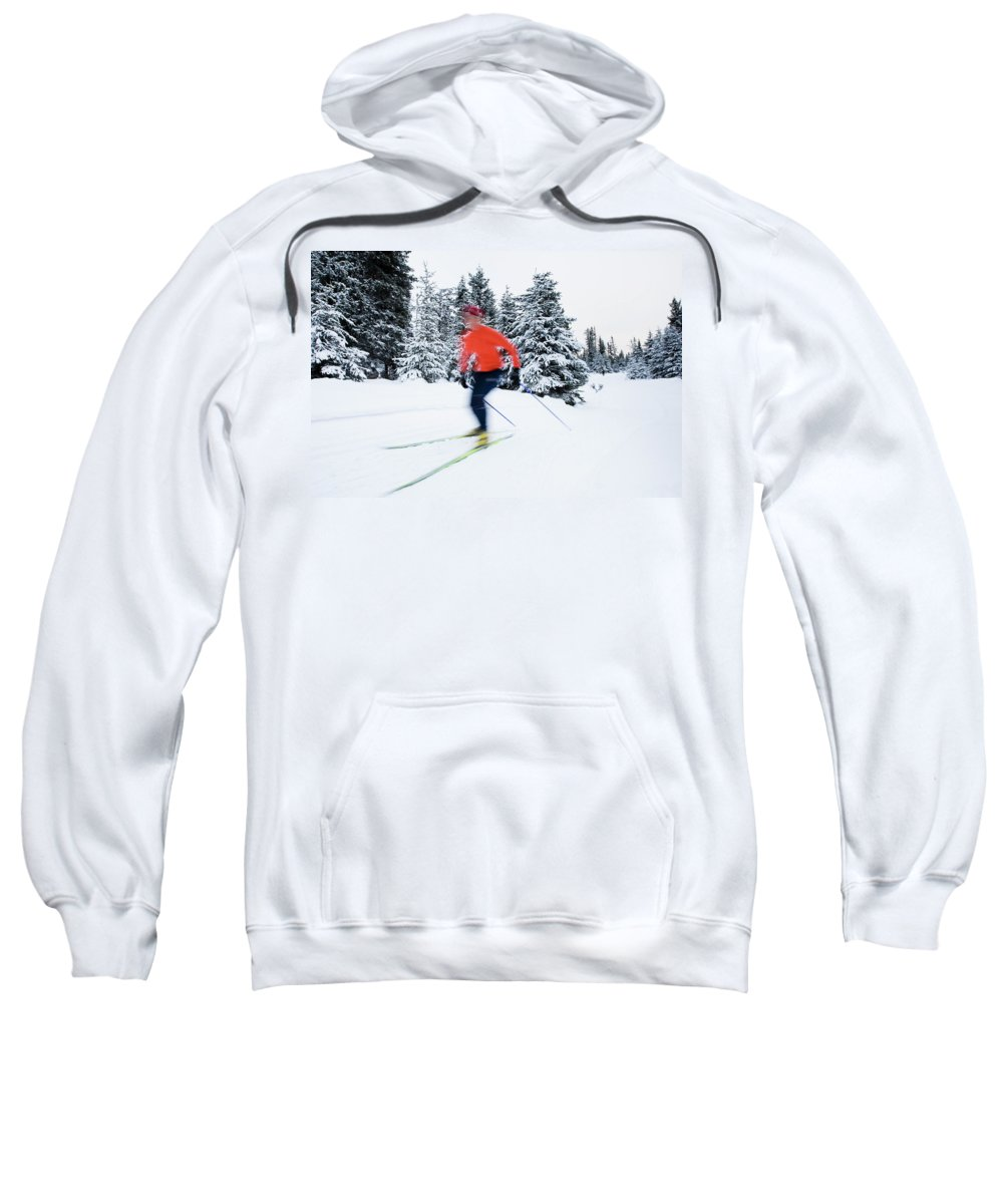 Action Sweatshirt featuring the photograph A Young Woman Cross-country Skiing by Scott Dickerson