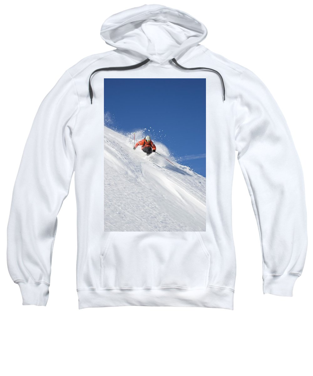 Active Sweatshirt featuring the photograph A Young Man Skis Untracked Powder by Henry Georgi