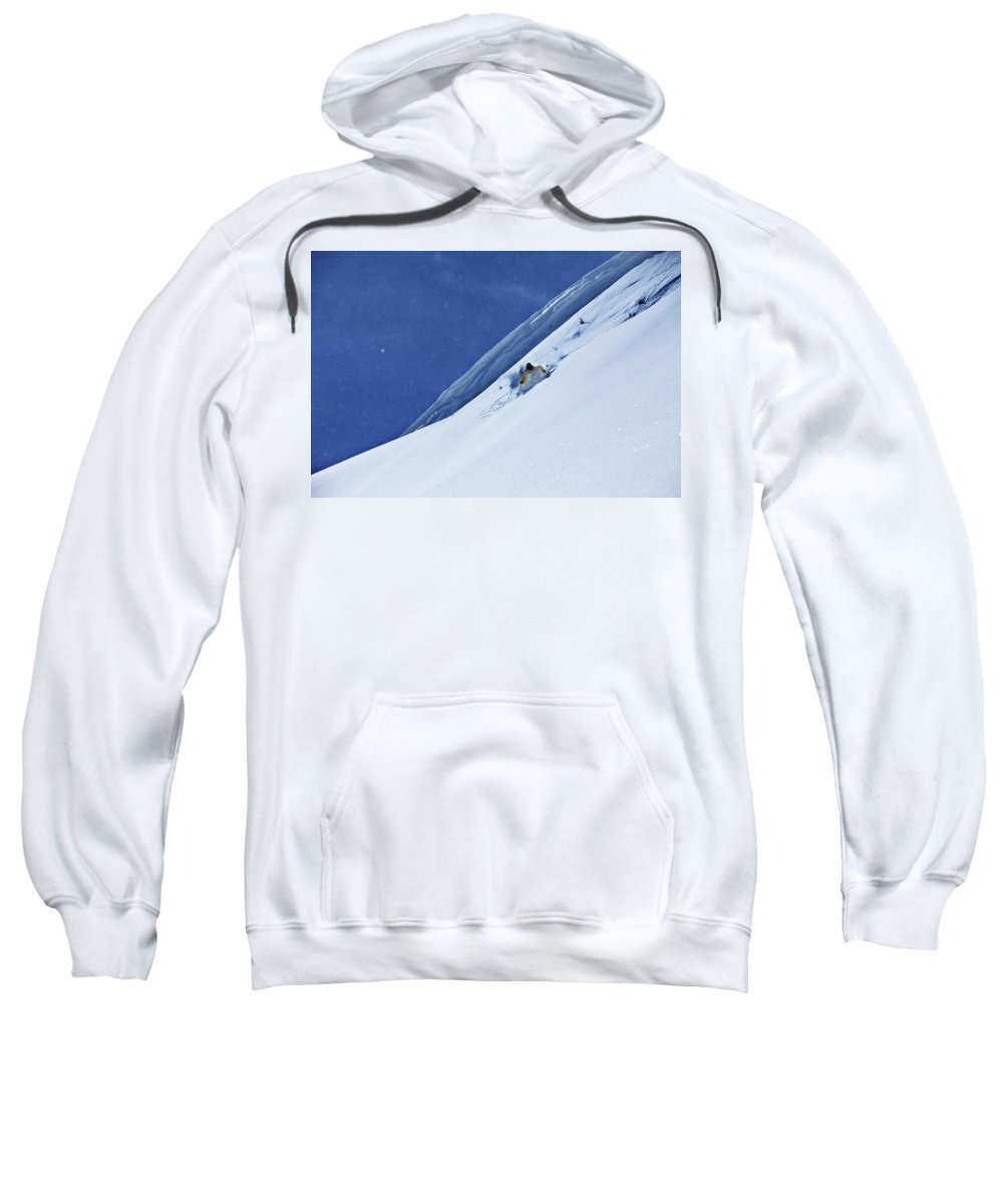 20-24 Years Sweatshirt featuring the photograph A Athletic Skier Rips Fresh Deep Powder by Patrick Orton