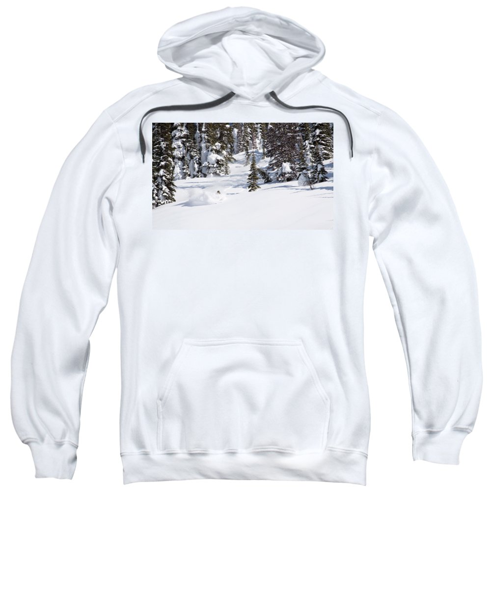 30-34 Years Sweatshirt featuring the photograph A Backcountry Skier A Turn Near Ymir by Craig Moore