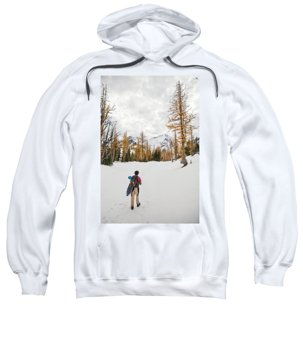 20-29 Years Sweatshirt featuring the photograph A Backpacker Hikes Through Snow by Christopher Kimmel