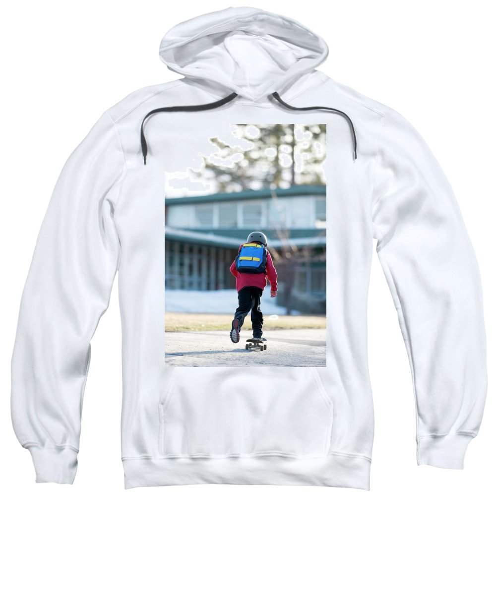 10-11 Years Sweatshirt featuring the photograph A Boy Rides His Skateboard In Lake by Corey Rich