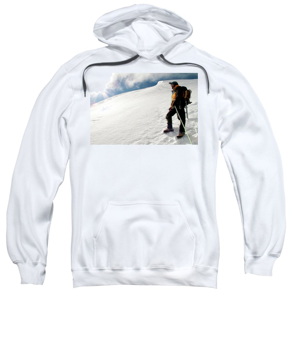 30-34 Years Sweatshirt featuring the photograph A Climber On The Glacier Of Cotopaxi by Caroline Bennett