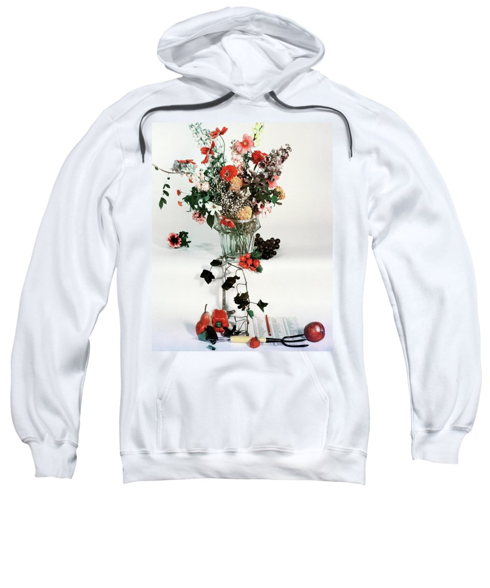 Nobody Sweatshirt featuring the photograph A Studio Shot Of A Vase Of Flowers And A Garden by Herbert Matter
