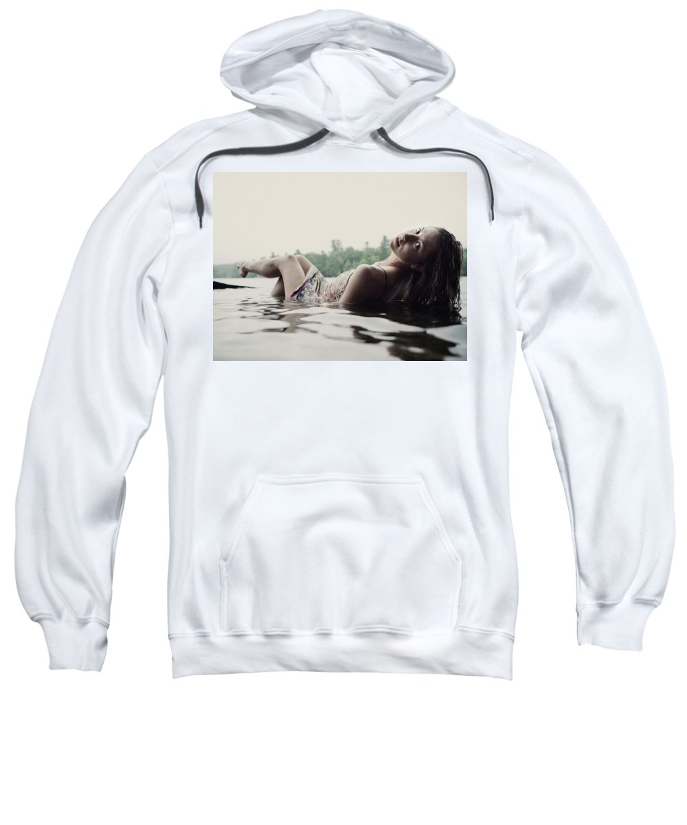 20-24 Years Sweatshirt featuring the photograph A Young Woman In A White Dress Relaxes by Chris Bennett