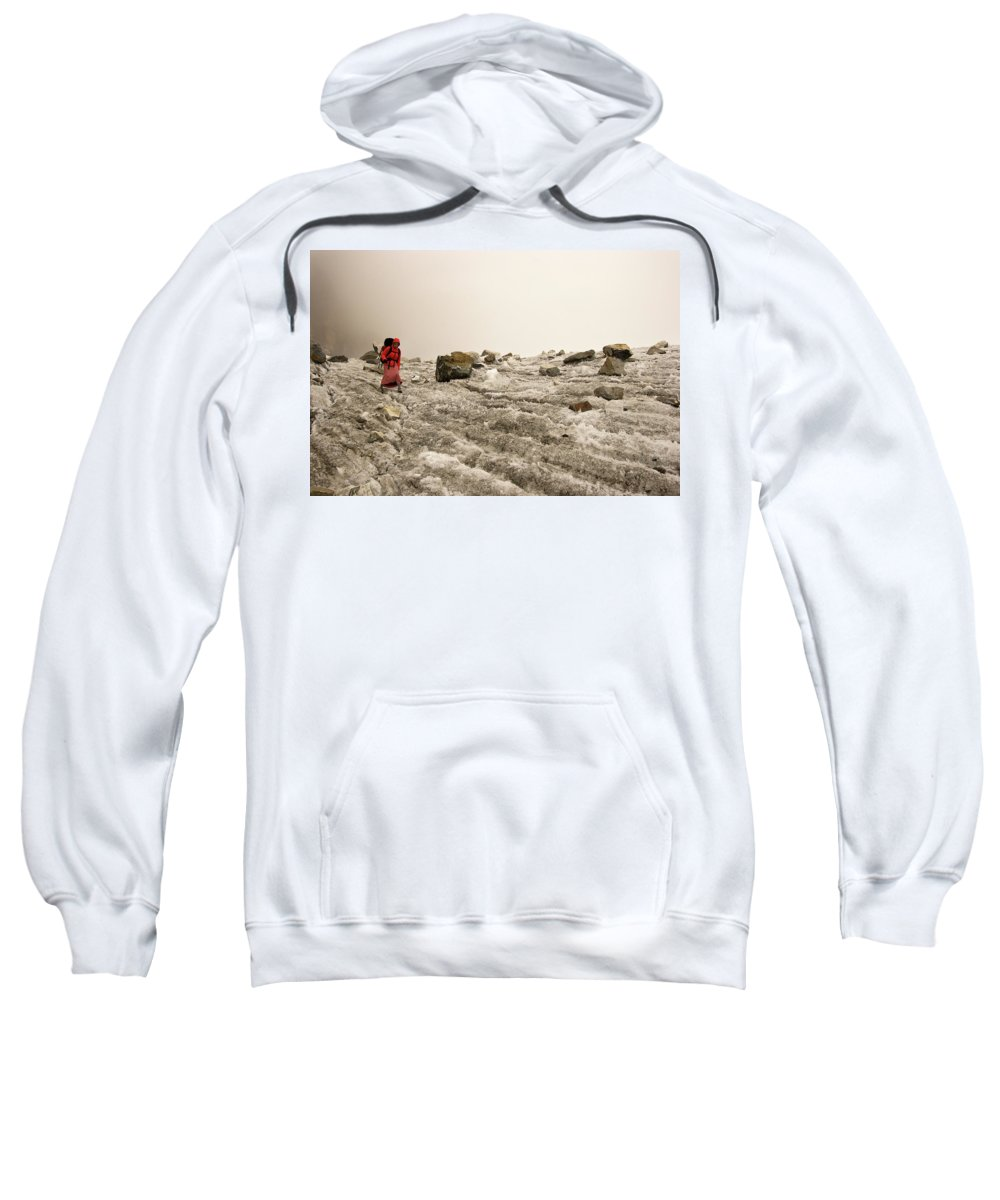 Adventure Sweatshirt featuring the photograph A Young Woman Treks Down From Cho La by Mark Fisher