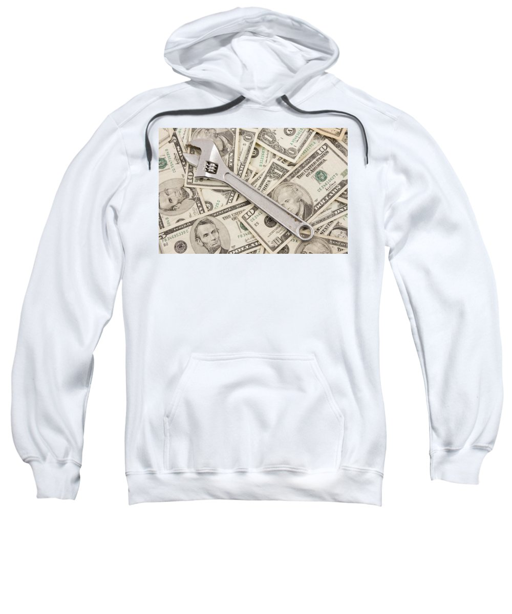 Money Background Sweatshirt featuring the photograph Adjustable Wrench On Pile Of Money by Keith Webber Jr