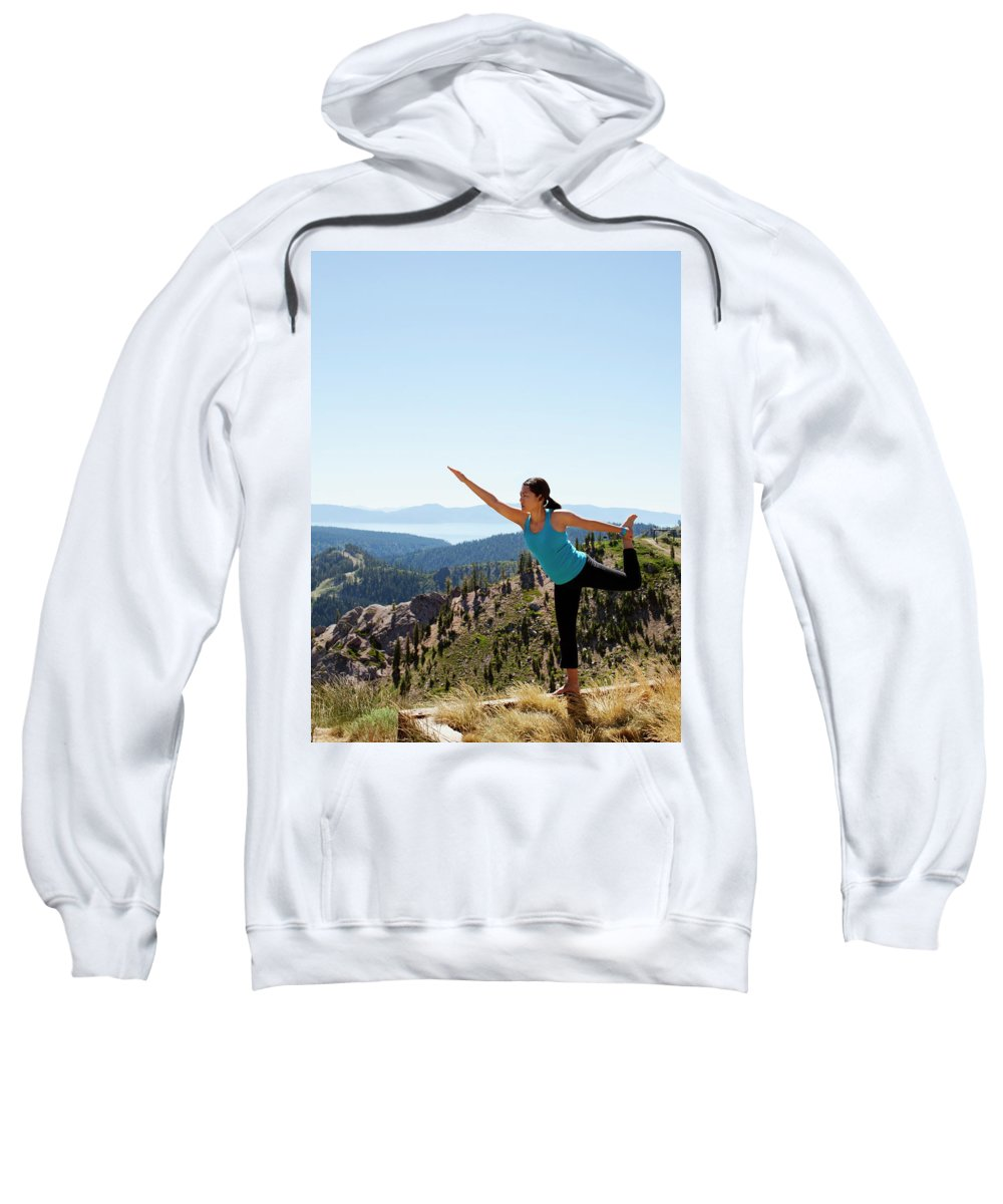 30-34 Years Sweatshirt featuring the photograph Asian Woman Practicing Yoga Outdoors by Matthew Wakem