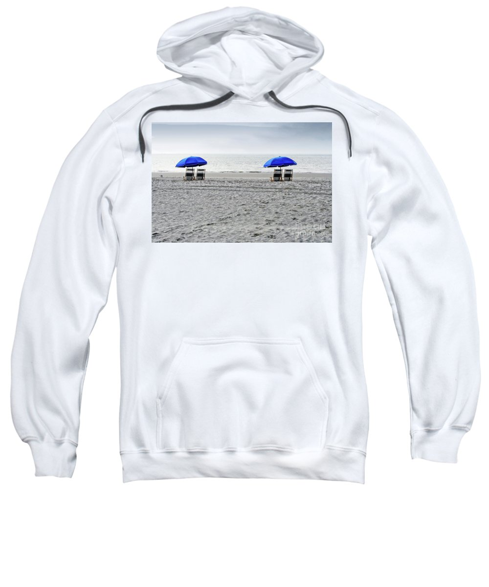 Hilton Head Sweatshirt featuring the photograph Beach Umbrellas On A Cloudy Day by Thomas Marchessault