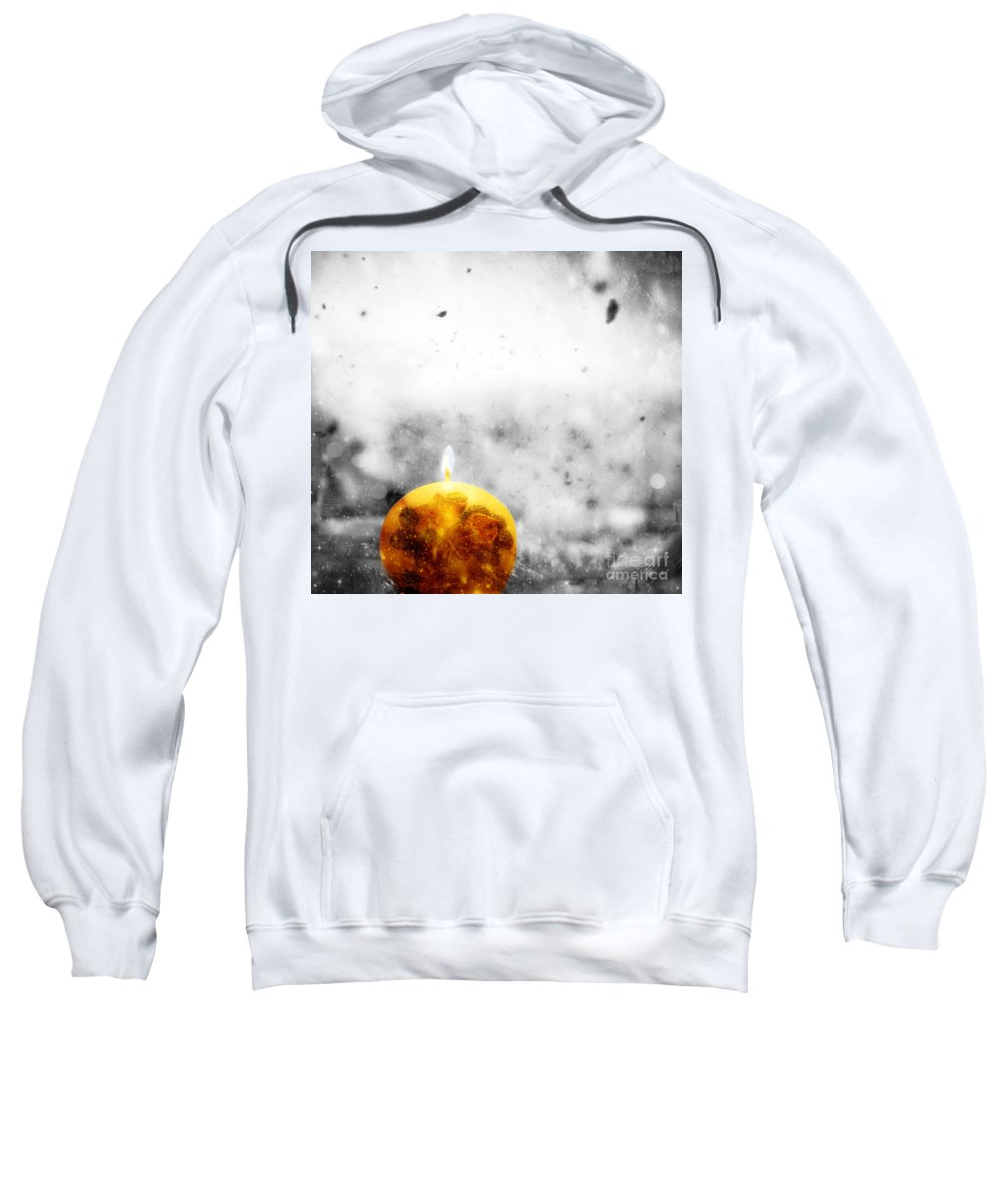 Winter Sweatshirt featuring the photograph Christmas Ball Candle Lights On Winter Background by Michal Bednarek
