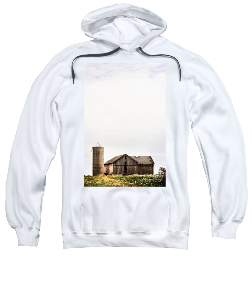 Old; Farm; Barn; Rural; Outside; Outdoors; Aged; Silo; Building; Architecture; Wood; Wooden; Grass; Worn; Field; Weeds; Out Of Focus; Blur; Blurry; Blurred; Queen Anne's Lace; Dried; Dry; Fall; Autumn; Brown; Carrot Weed Sweatshirt featuring the photograph Fading Past by Margie Hurwich