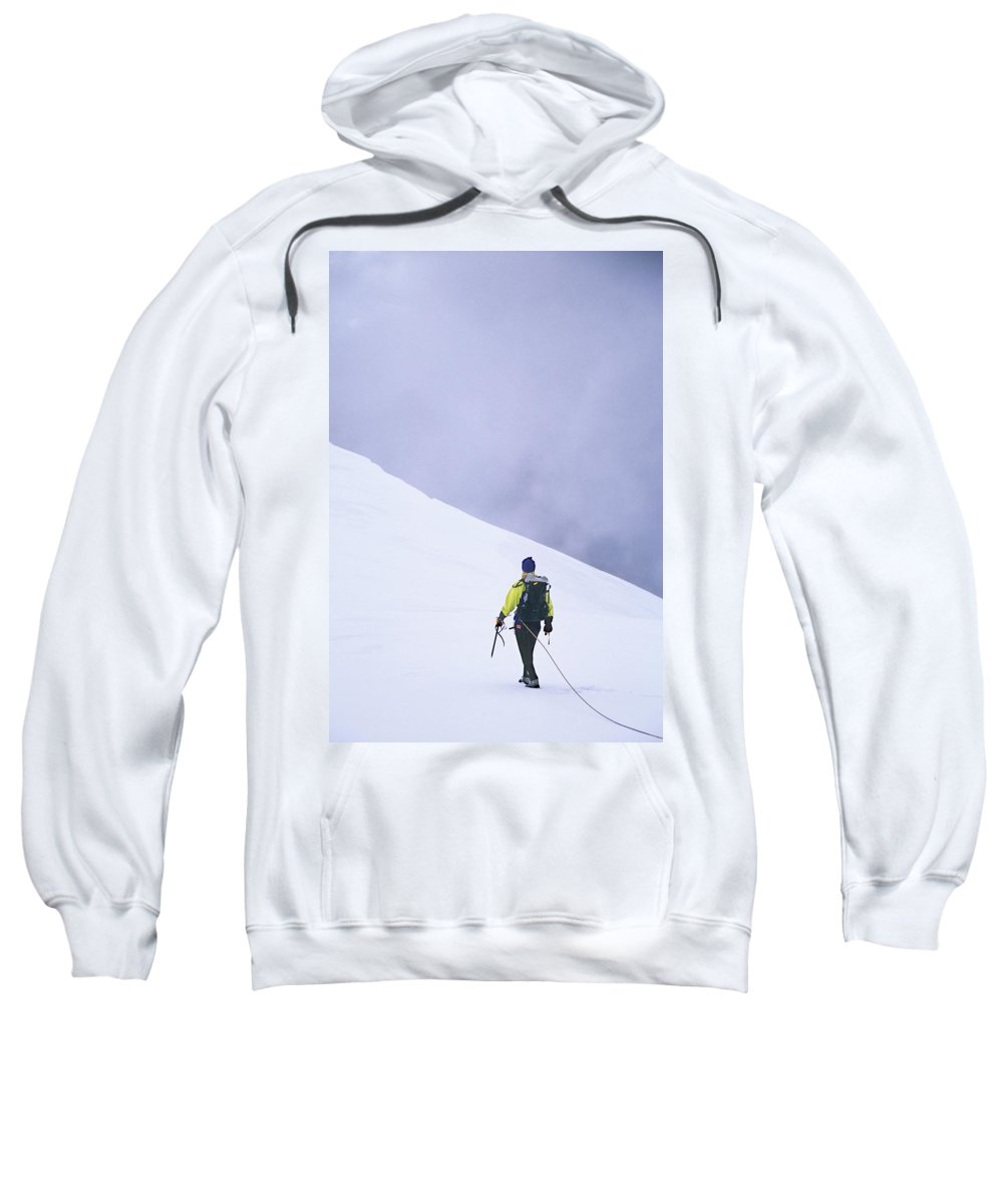 Adventure Sweatshirt featuring the photograph Female Mountaineer Climbing A Glacier by Tyler Stableford