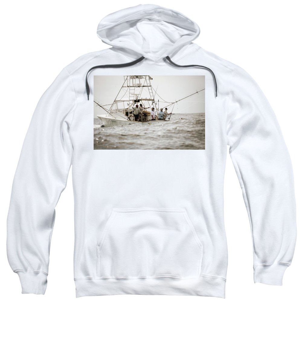 Fishing Reel Sweatshirt featuring the photograph Fishermen Reel In Line From The Back by Chris Ross