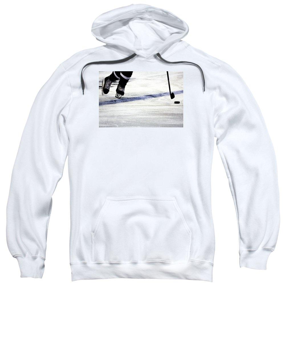 Hockey Sweatshirt featuring the photograph He Skates by Karol Livote