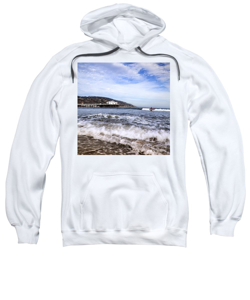 Malibu Beach Pier Photographs Sweatshirt featuring the photograph Ocean Waves Blue Sky And A Surfer At Malibu Beach Pier by Jerry Cowart