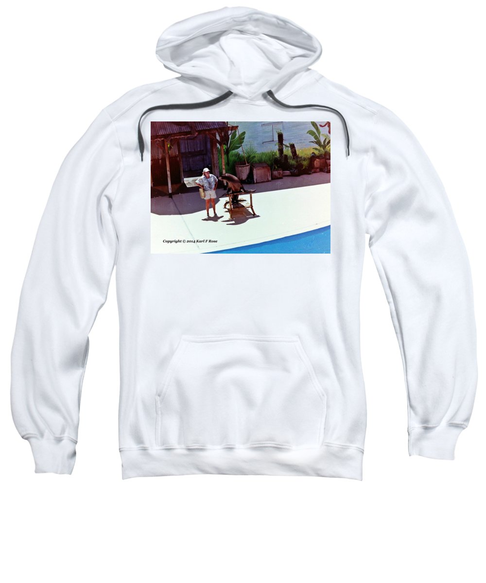Seals Sweatshirt featuring the photograph Seal And Trainer by Karl Rose