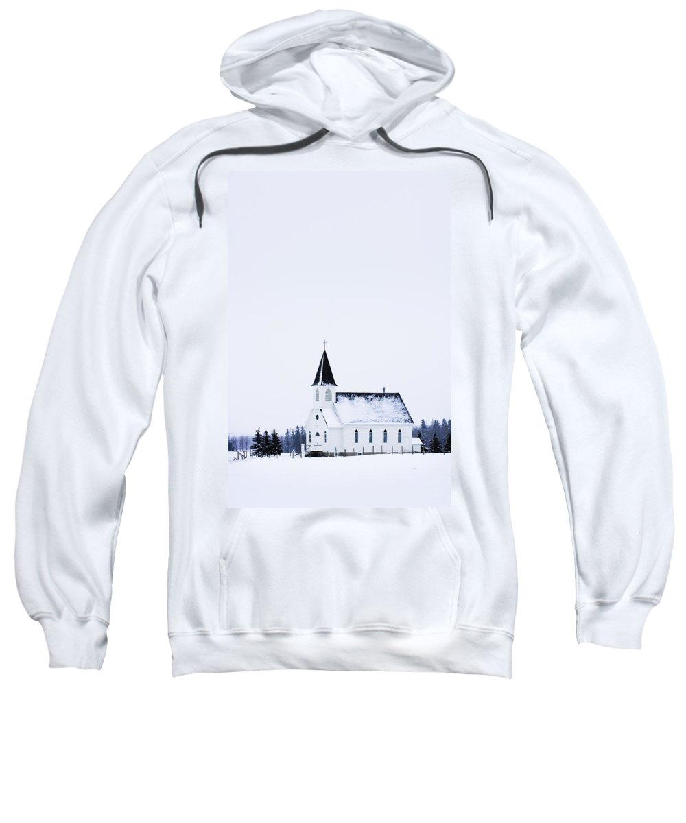 Ice Sweatshirt featuring the photograph Old Fashioned Steeple Church In Winter by Corey Hochachka