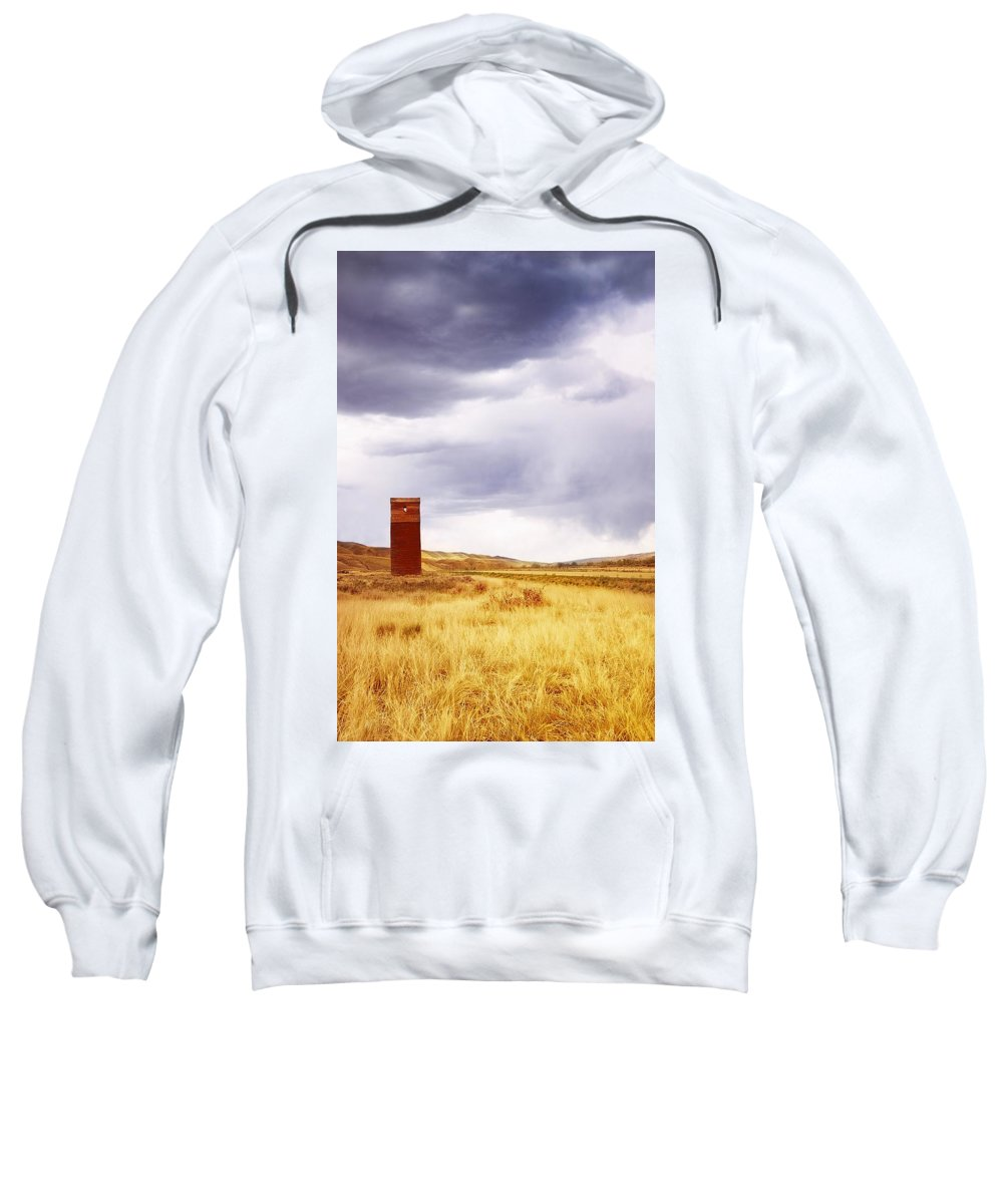 Agriculture Sweatshirt featuring the photograph A Grain Elevator In A Field by Chris Knorr