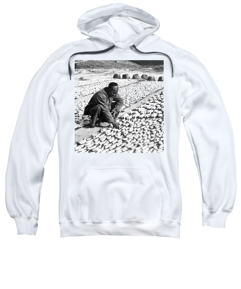 Chinese Sweatshirt featuring the photograph Chinese Man Drying Fish On The Shore - C 1902 by International Images