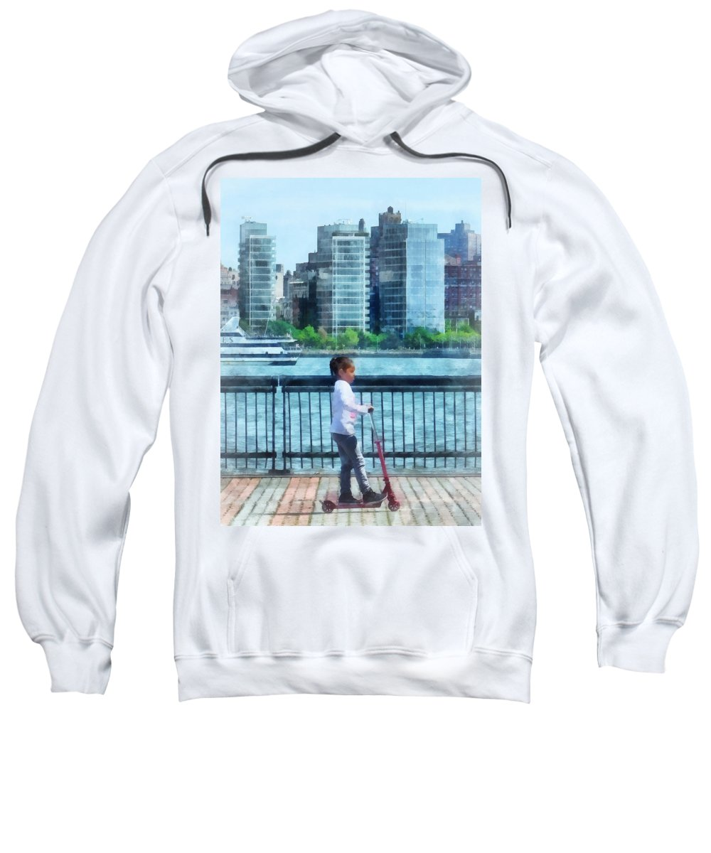 Girl Sweatshirt featuring the photograph Little Girl On Scooter By Manhattan Skyline by Susan Savad