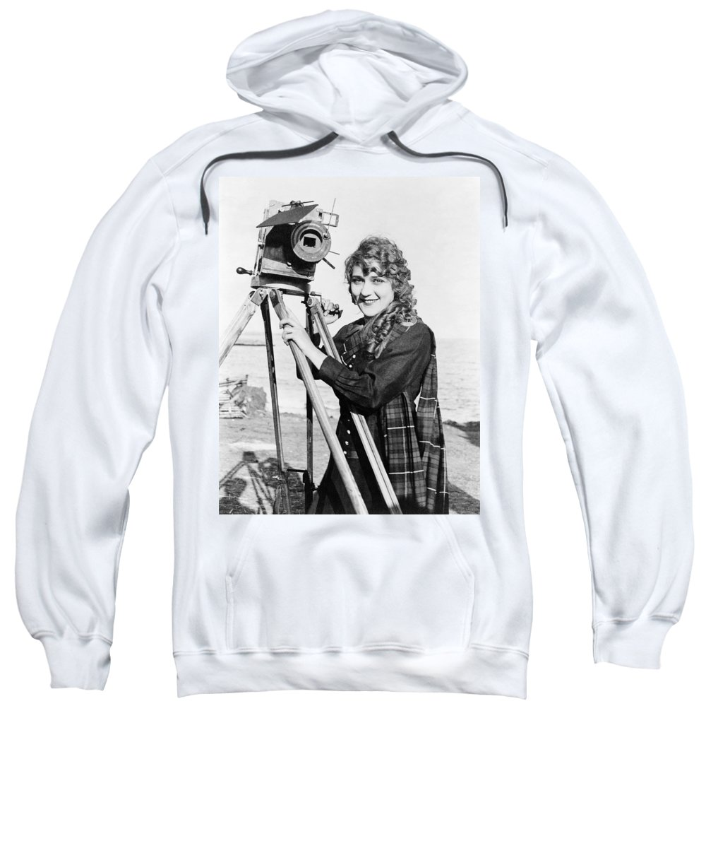 1916 Sweatshirt featuring the photograph Mary Pickford (1893-1979). Born Gladys Mary Smith. American Actress, With A Movie Camera On A Beach, C1916 by Granger