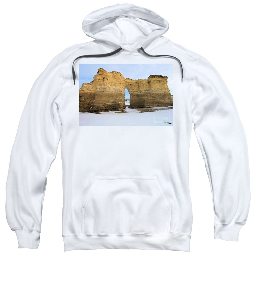 Monument Rocks Sweatshirt featuring the photograph Monument Rocks Arch by Adam Jewell