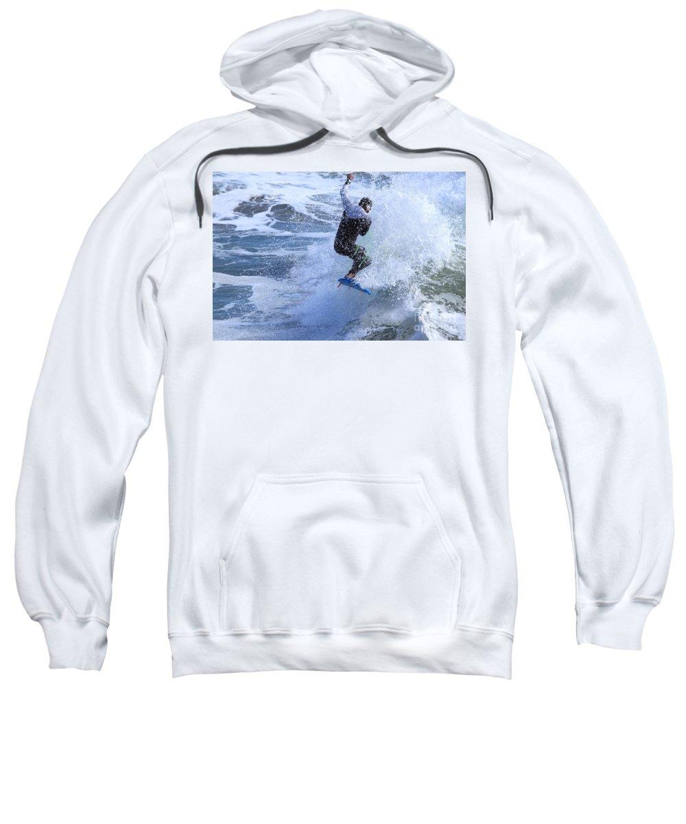 Surfing Sweatshirt featuring the photograph Surfer by Henrik Lehnerer