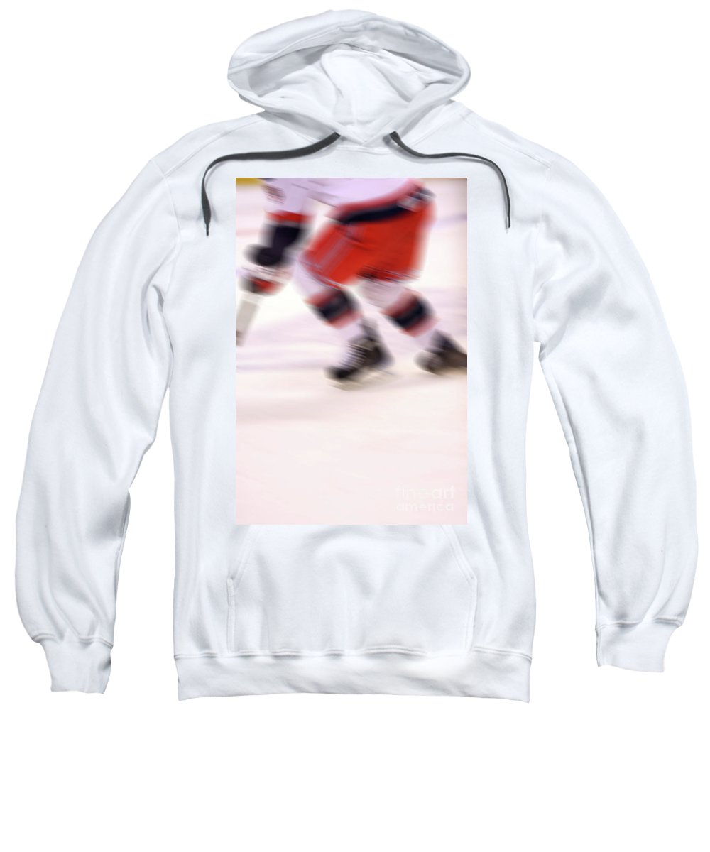 Hockey Sweatshirt featuring the photograph A Blur Of Ice Speed by Karol Livote