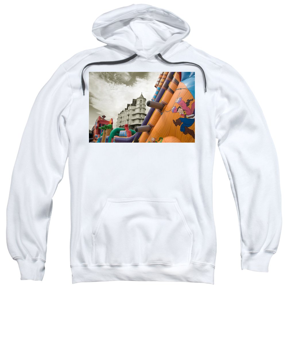 Childrens Sweatshirt featuring the photograph Childrens Play Areas Contrast With The Victorian Elegance Of The Grand Hotel In Llandudno Wales Uk by Mal Bray