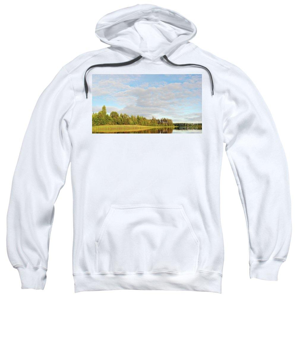 Area Sweatshirt featuring the photograph Coast Of Summer Lake Shined With Sun Beams by Vadzim Kandratsenkau
