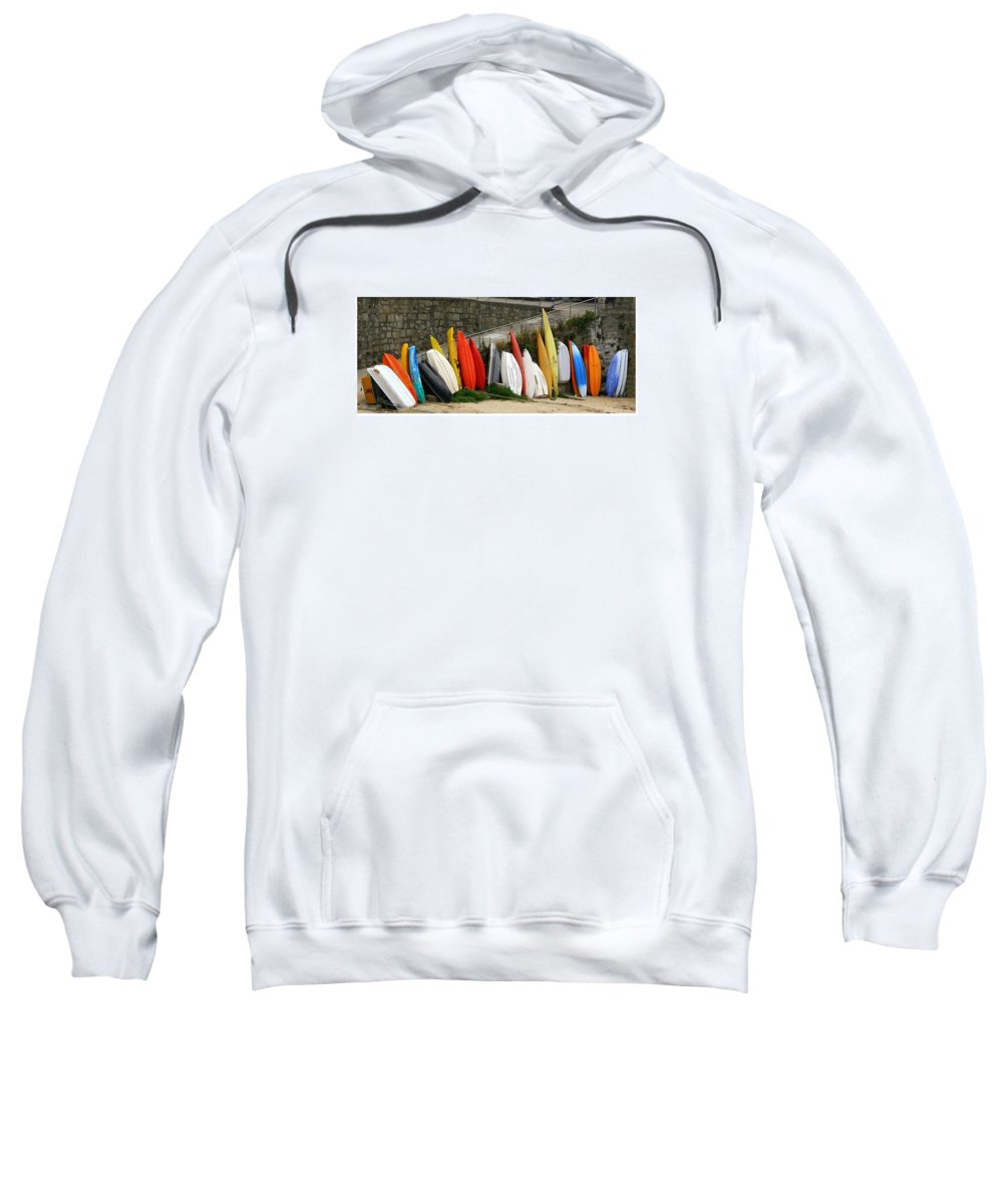 Colorful Line Of Stacked Punts Against The Seawall In Devonshire Sweatshirt featuring the photograph Dinghy Conga Line by Jack Pumphrey