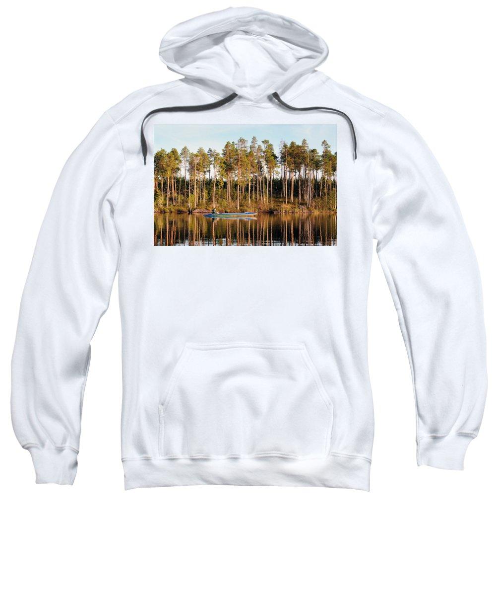 Attractive Sweatshirt featuring the photograph Fisherman On Evening Lake by Vadzim Kandratsenkau