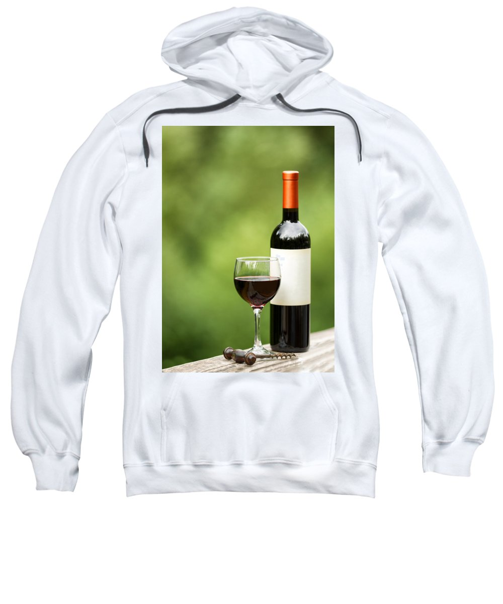 Wine Sweatshirt featuring the photograph Glass Of Red Wine Outdoors Ready To Enjoy by Thomas Baker