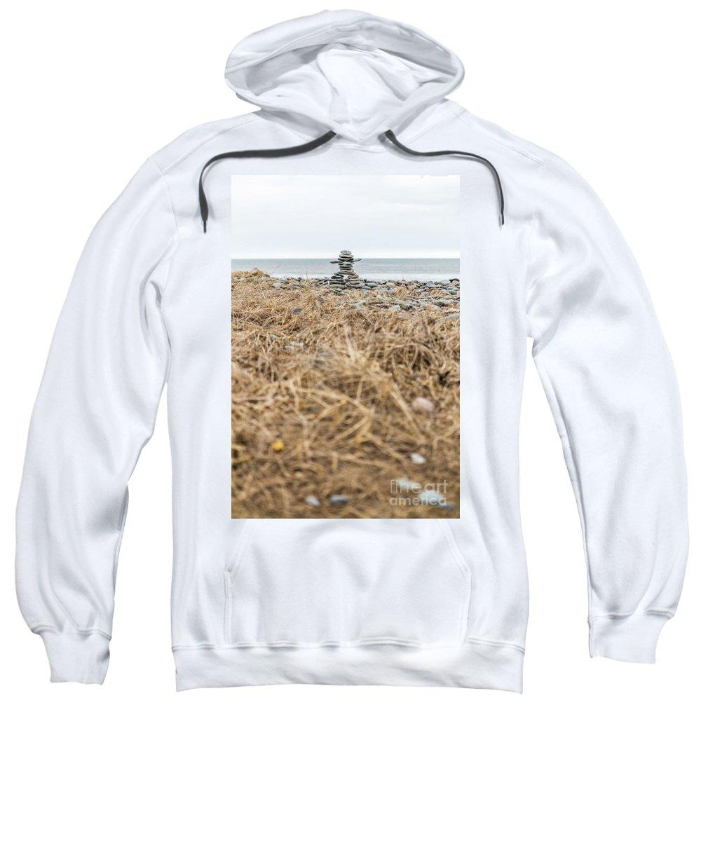 Atlantic Canada Sweatshirt featuring the photograph Inukshuk At Lawrencetown Beach, Nova Scotia by Mike Organ