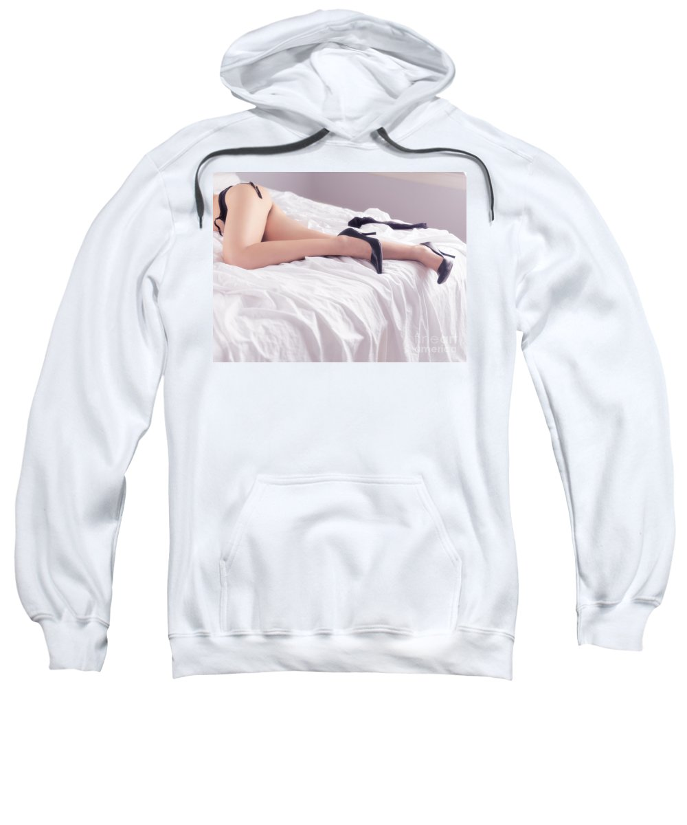 Sex Sweatshirt featuring the photograph Legs Of Sexy Half-naked Woman Lying In Bed by Oleksiy Maksymenko