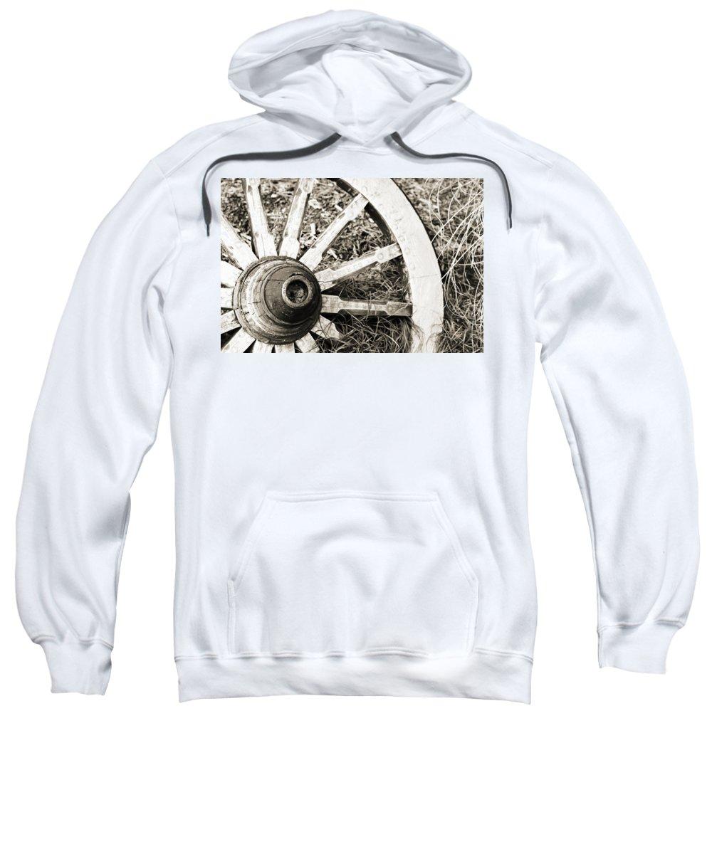 Artsy Sweatshirt featuring the photograph Old Wagon Wheel by Marilyn Hunt