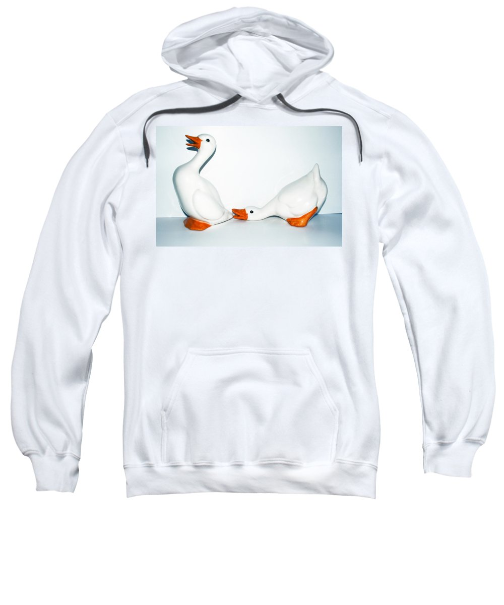 Goose; Geese; Ceramic; Statue; Figure; Figurine; Play; Playful; Bite; Nip; Bird; Fowl; Waterfowl; Ba Sweatshirt featuring the photograph Playful Geese by Allan Hughes