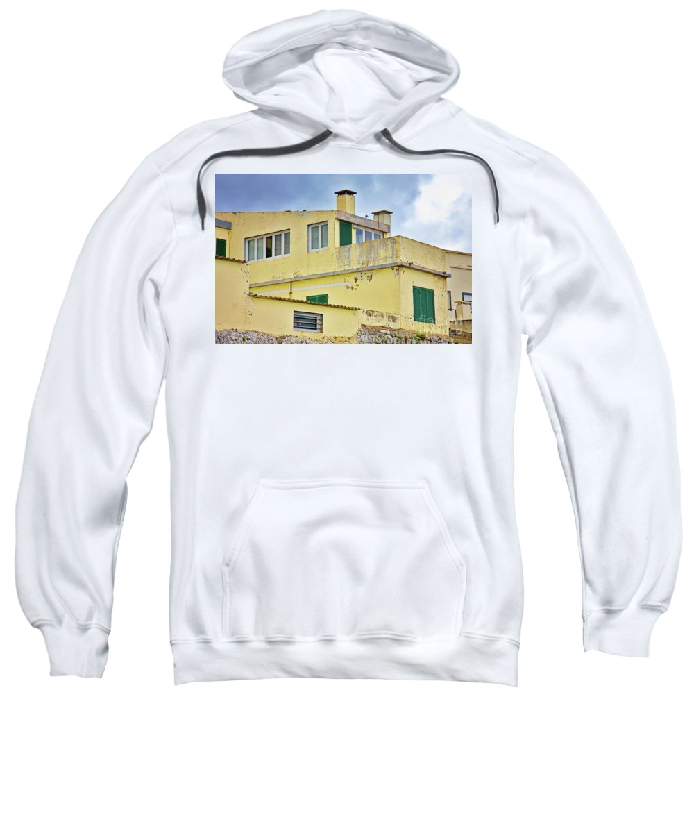 Home Sweatshirt featuring the photograph Yellow Worn Out Concrete House by Jan Brons
