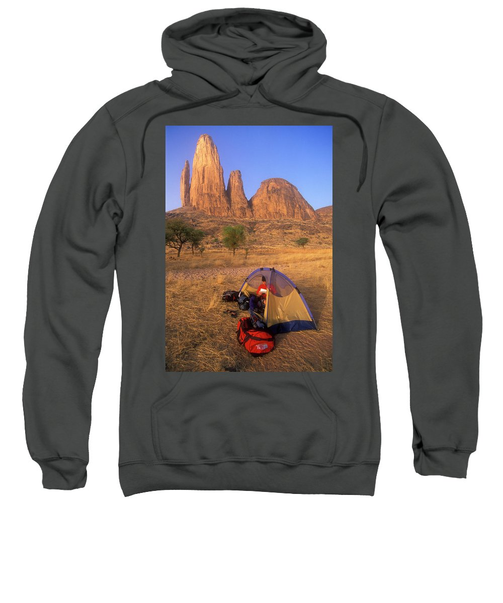 Africa Sweatshirt featuring the photograph A Man Reads In His Tent Below The Hand by Jimmy Chin