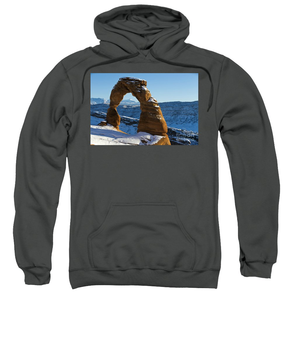 Arches Sweatshirt featuring the photograph Delicate Arch With Snow Arches National Park Utah by Jason O Watson