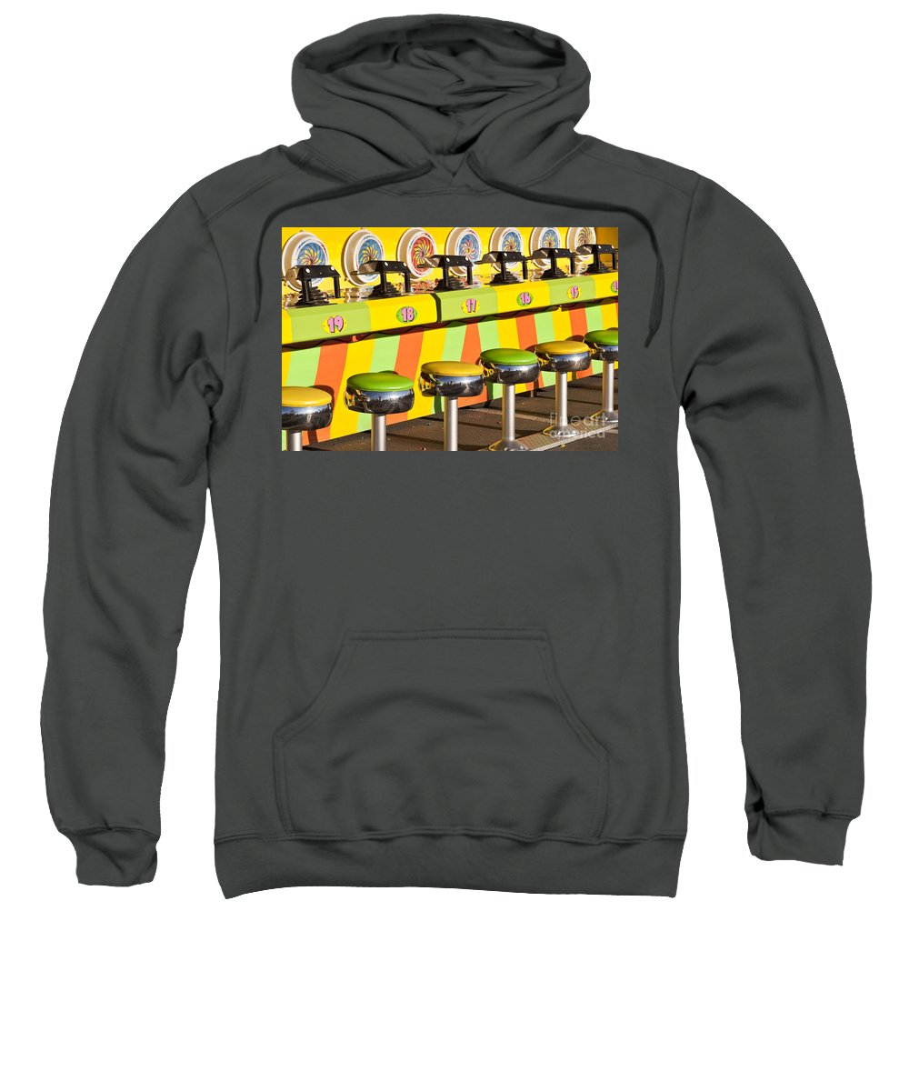 Americana Sweatshirt featuring the photograph Evergreen State Fair Midway Game With Coloful Stools And Squirt by Jim Corwin