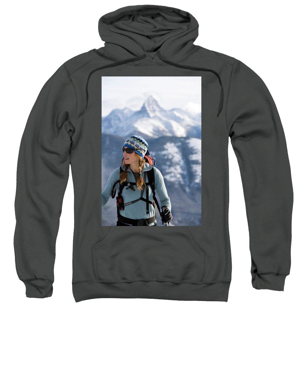 Action Sweatshirt featuring the photograph Female Backcountry Skier Skinning by Heath Korvola