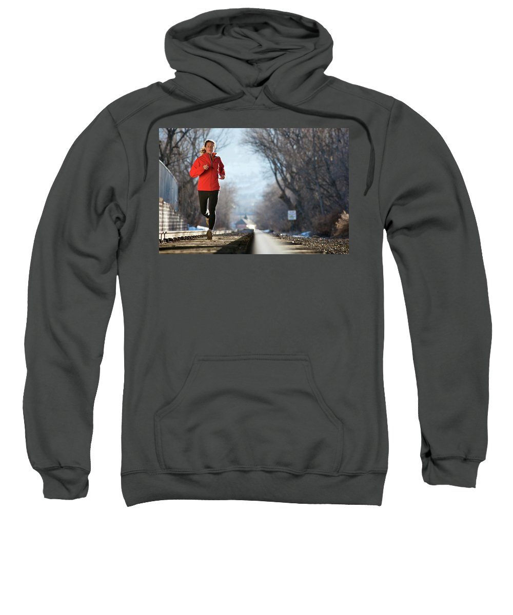 20s Sweatshirt featuring the photograph A Woman Running Near A Railroad Track by Celin Serbo